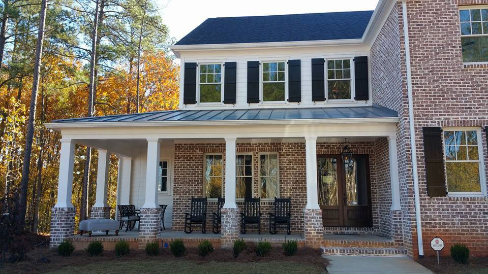Snaplock onyx metal roof on a brick-walled house