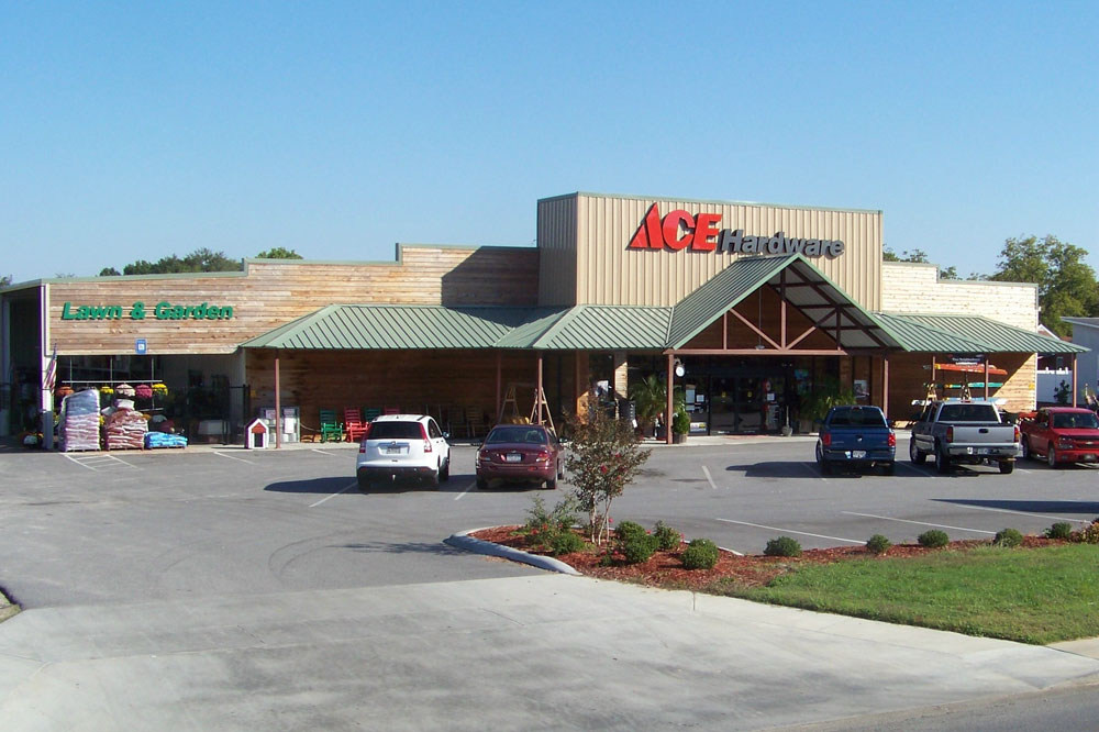 Colony green metal roof awning for an Ace Hardware store